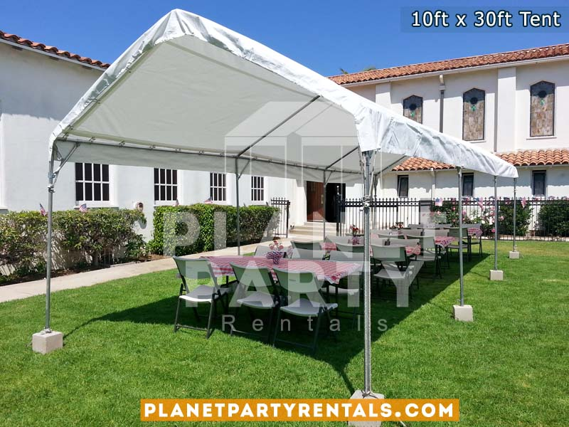 10ft x 30ft Tent on grass with rectangular tables and white chairs| Tent rentals San Fernando Valley