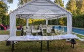 14ft x 30ft Tent with plastic chairs and rectangular tables